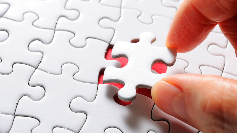 jigsaw-puzzle-piece-hand